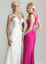6649: This haltered V-neck style from Night Moves comes in raspberry and white. Made of chiffon that drapes elegantly over the hips, style 6649 is ideal for many formal events due to its classic silhouette and glamorous air. A-B beading covers the center of the bodice in a flower-like pattern, as well as the center of the back in a similar fashion. This week only, at Glitterati ,(the week of 7/7) this style is 50% off so come on in and try it on!